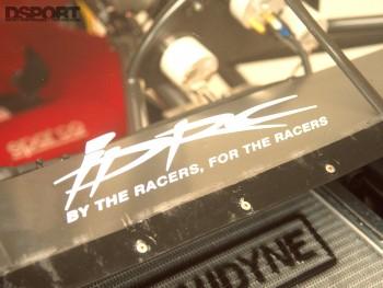 IDRC sticker on Papadakis' AEM Drag Civic engine