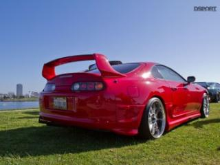 Rear of red toyota supra in Long Beach