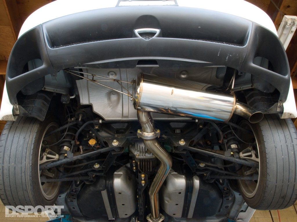 The Racing beat muffler installed on the Mazda RX-8