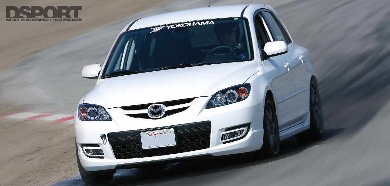 Mazdaspeed3 taking a corner on the track
