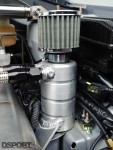 A custom aluminum oil catch tank connected with –AN fittings relieves crankcase pressure and traps oil carried in blow-by gasses