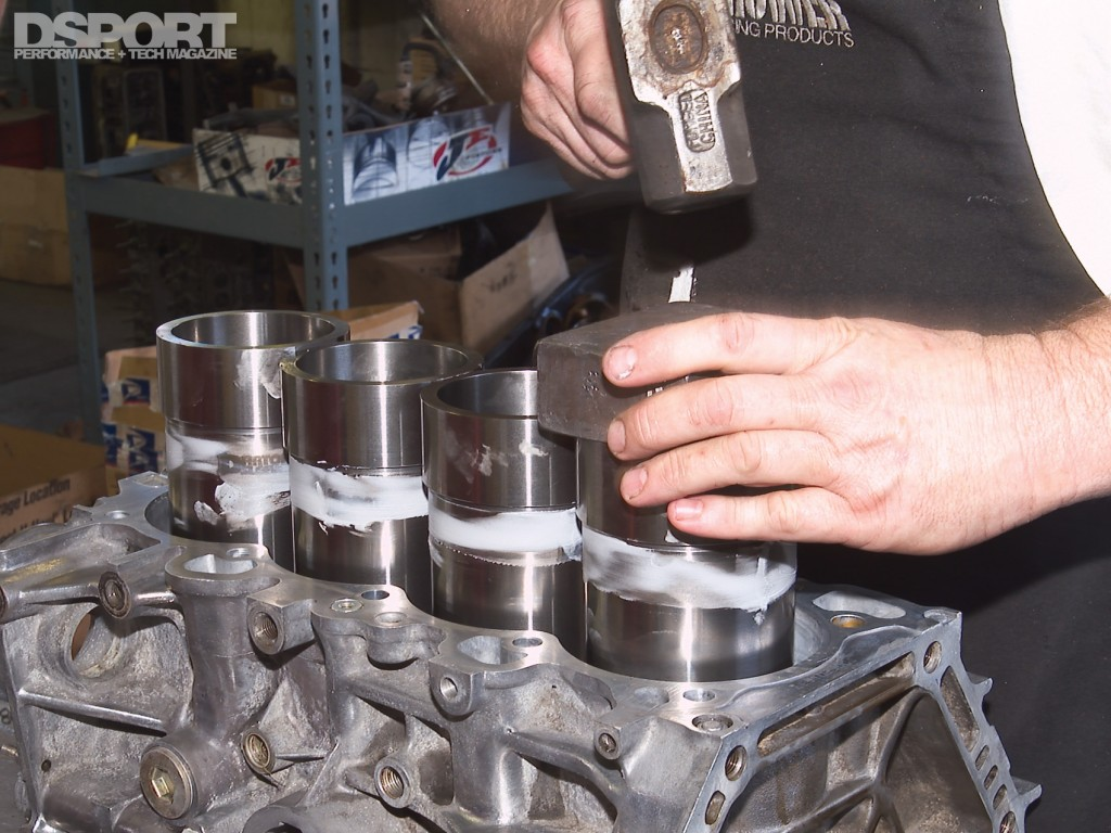 Putting in sleeves with a hammer into an engine block