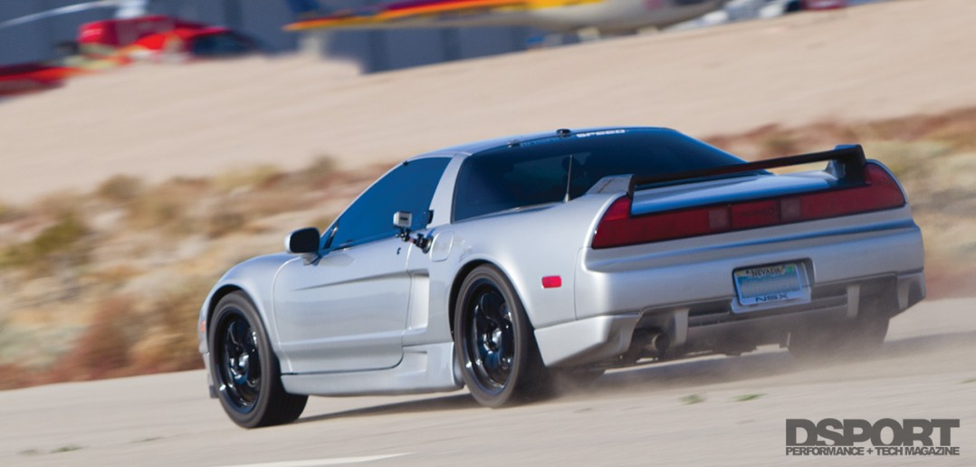 The turbocharged Acura NSX doing blasts on the airport runaway