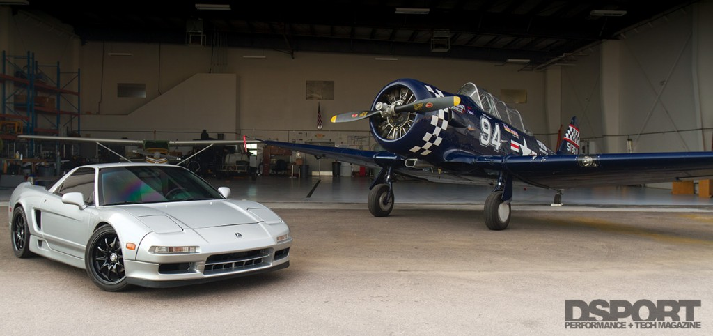 The turbocharged Acura NSX sitting in the plane hangar