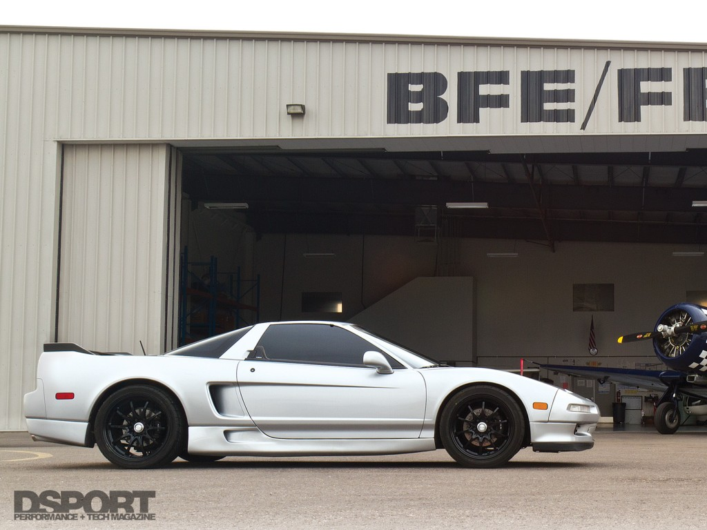 Turbocharged Acura NSX outside of the airport hangar
