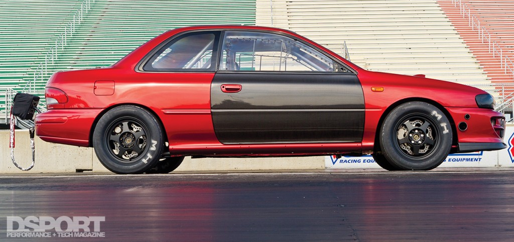 Side profile of the Subaru Impreza RS at the track