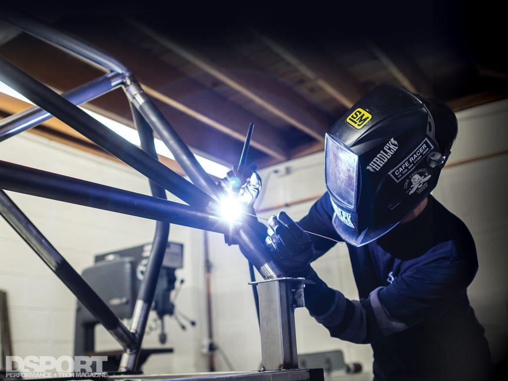 Len Higa welding a cage